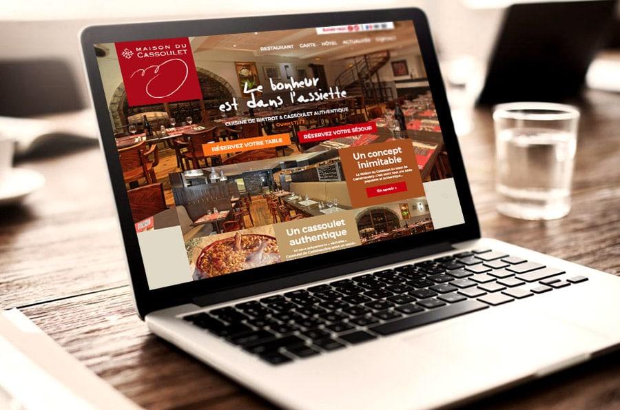 Defacto agence de communication à Narbonne - refonte du site de la Maison du Cassoulet - Ordinateur portable